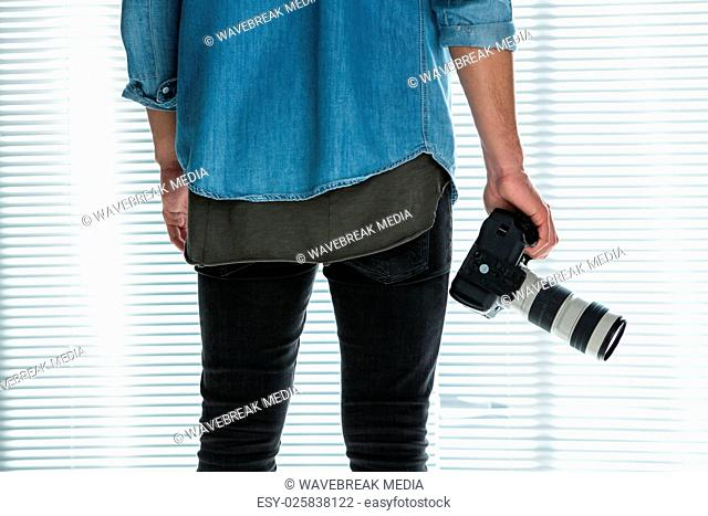 Male photographer with digital camera