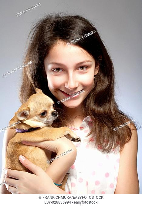 Portrait of a Preadolescent Girl with a Little Dog