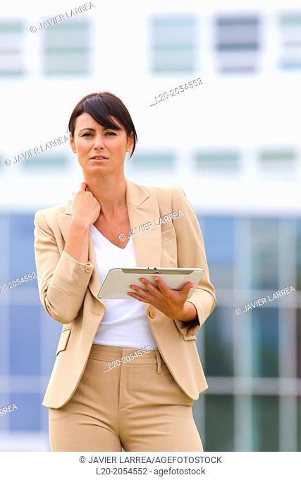 Business woman with tablet in business center. San Sebastian Technology Park. Donostia. Gipuzkoa. Basque Country. Spain
