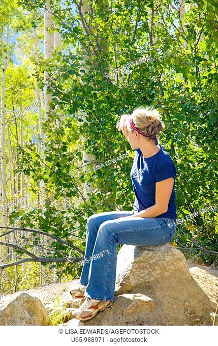Girl looking at Aspen trees, Colorado, USA