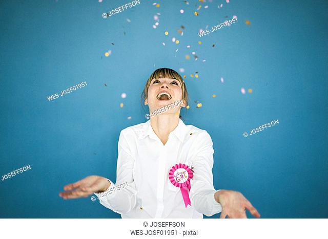 Confetti falling on woman celebrating her birthday