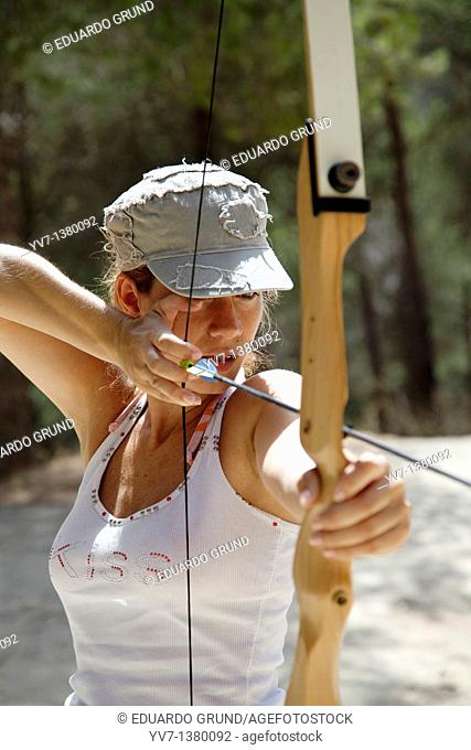 Young woman practicing archery, El Chorro, Malaga, Andalusia, Spain