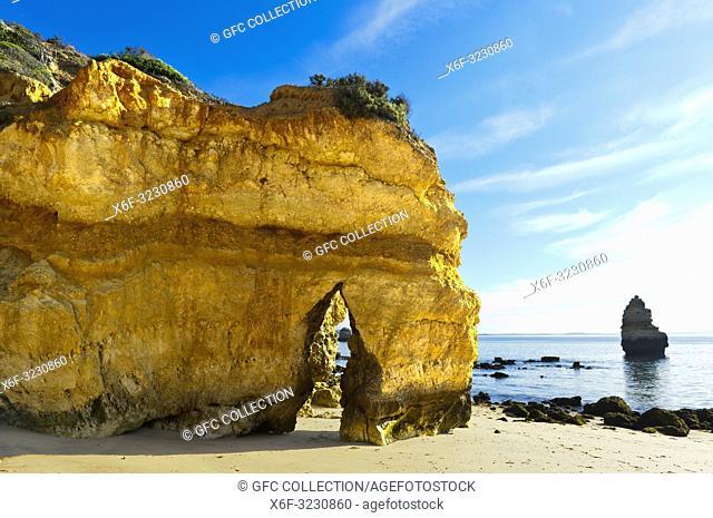 Yellow-golden cliff rocks at the Camilo beach, Praia do Camilo, Lagos, Algarve, Portugal
