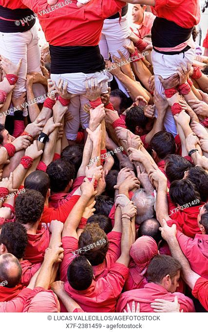 Colla Joves Xiquets de Valls.'Castellers' building human tower, a Catalan tradition.Fira de Santa Teresa, town festival. Plaça Vella.El Vendrell