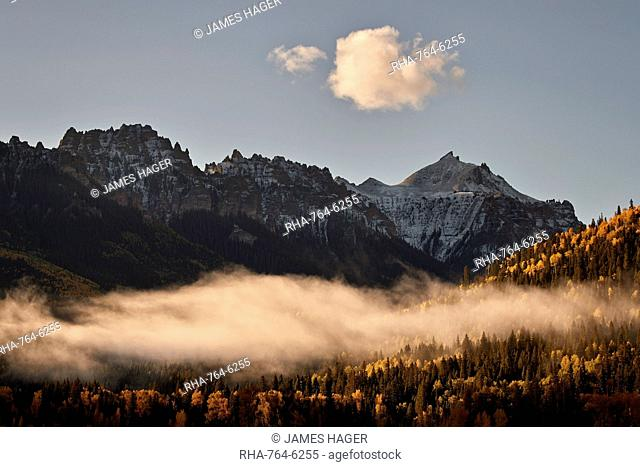 Snow-covered mountain in the fall with fog, Uncompahgre National Forest, Colorado, United States of America, North America