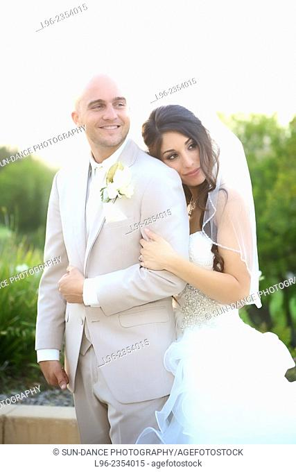 Happy married couple embracing on their wedding day