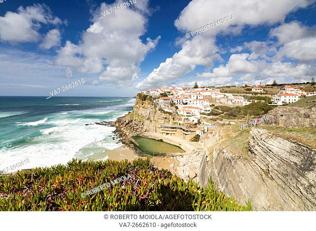 Top view of the perched village of Azenhas do Mar surrounded by the Atlantic Ocean and green vegetation Sintra Portugal Europe