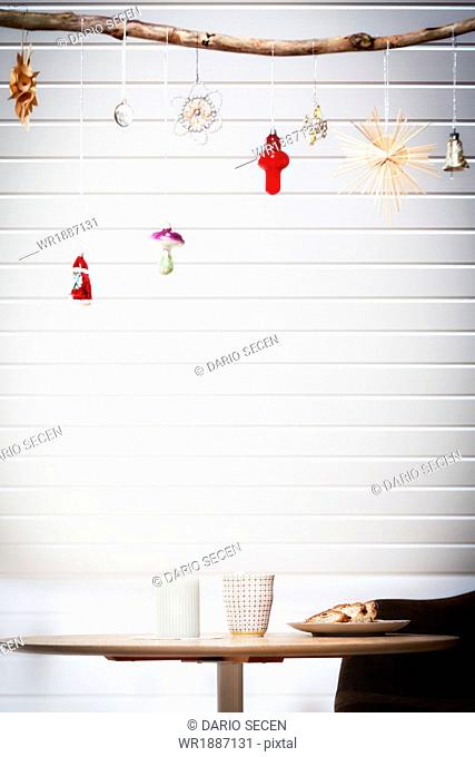 Christmas ornaments hanging from branch, Munich, Bavaria, Germany
