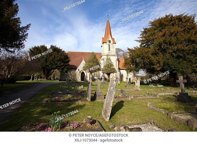 Holy Trinity Church  A country village church with spire and church yard