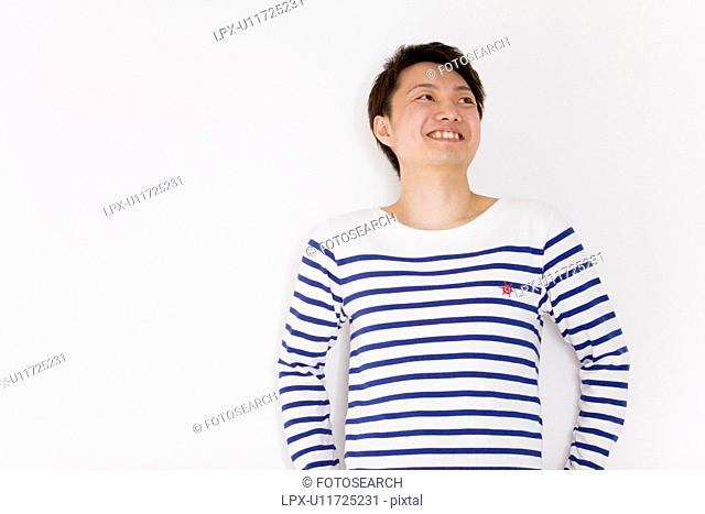 Young man looking away and smiling