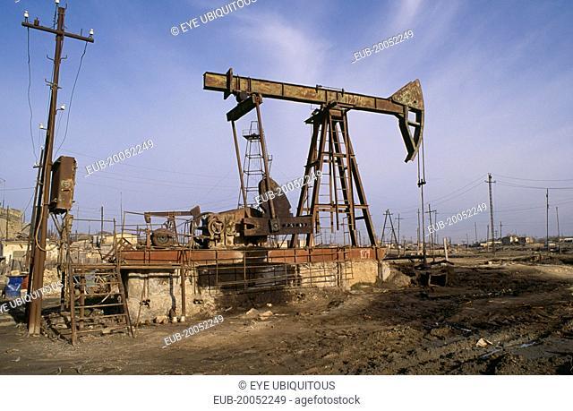 Nodding Donkey oil derrick on industrial site near Baku
