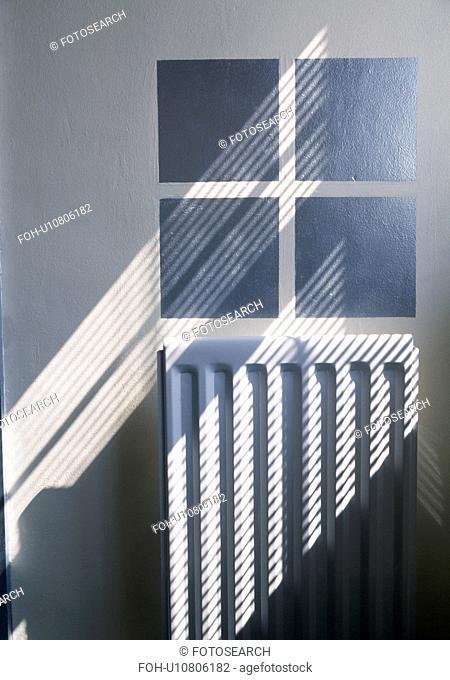 White radiator in small white4 hall