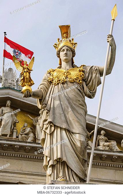 Pallas Athene Statue in front of the parliament building with the Austrian flag in the background