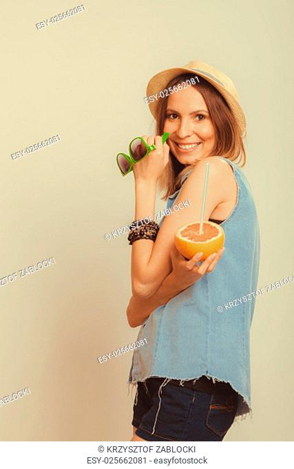 happy glad woman tourist in straw hat drinking grapefruit juice and holding sunglasses. healthy diet food. weight loss. summer vacation holidays