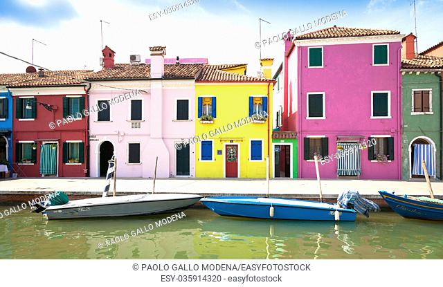 Burano Isle, close to Venice. Traditional colored houses during a sunny day