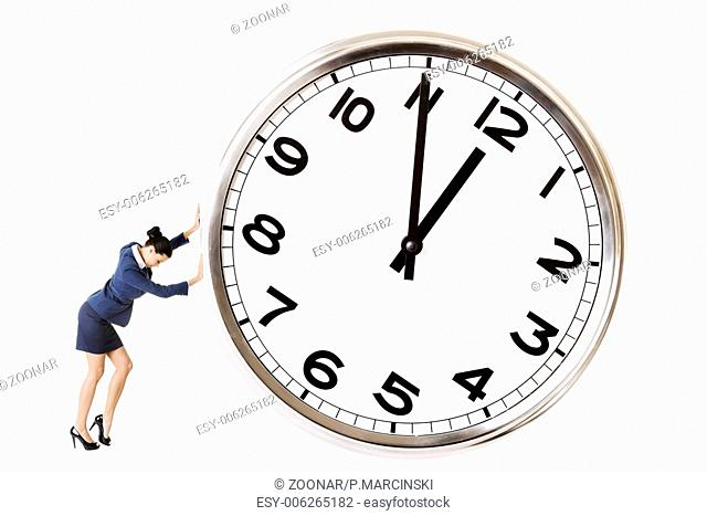 Businesswoman is pushing a big clock