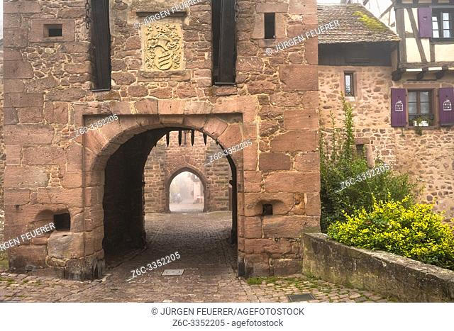 medieval rampart and town gate of village Riquewihr, touristy site of the Alsace Wine Route, France