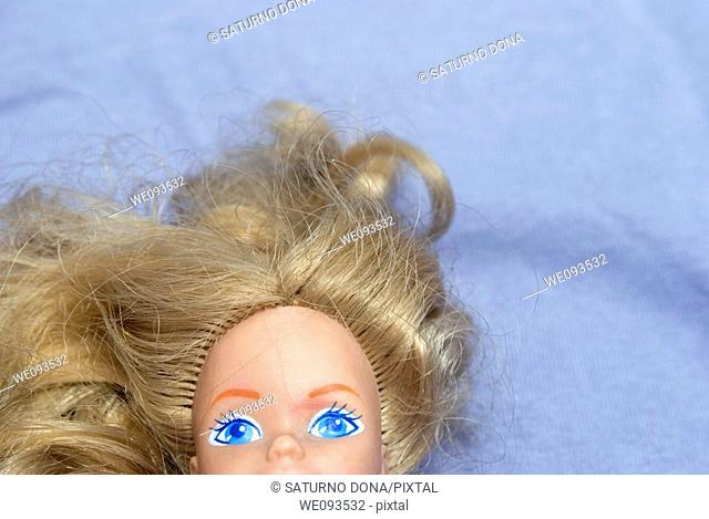 Doll lying on bed