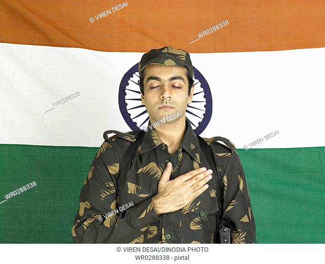 Indian army soldier taking oath in front of flag of India in background MR702A