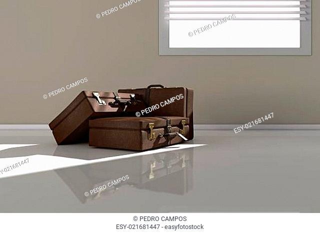 Suitcases near window
