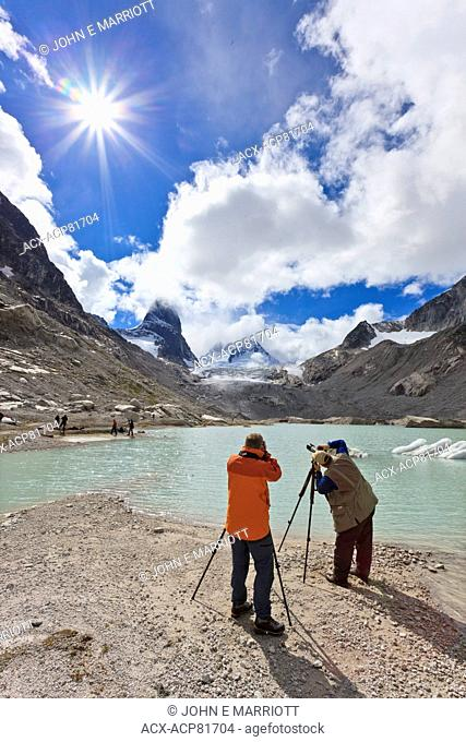 Landscape photographers taking pictures of the Vowell Glacier and Howser Tower in the Bugaboo Mountains, BC, Canada