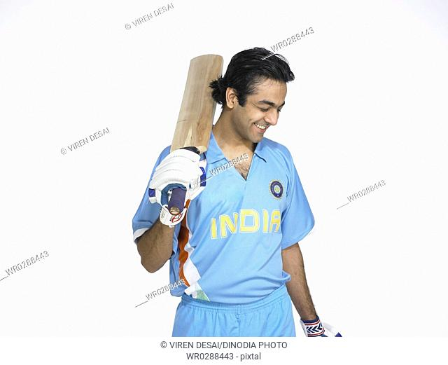 Indian batsman happy for good score in cricket match MR702A