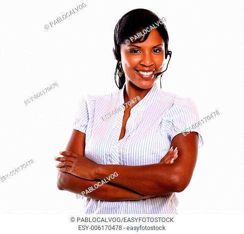 Charming call center employee smiling at you while wearing her headset on isolated background