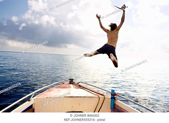 A man jumping into the sea, Thailand
