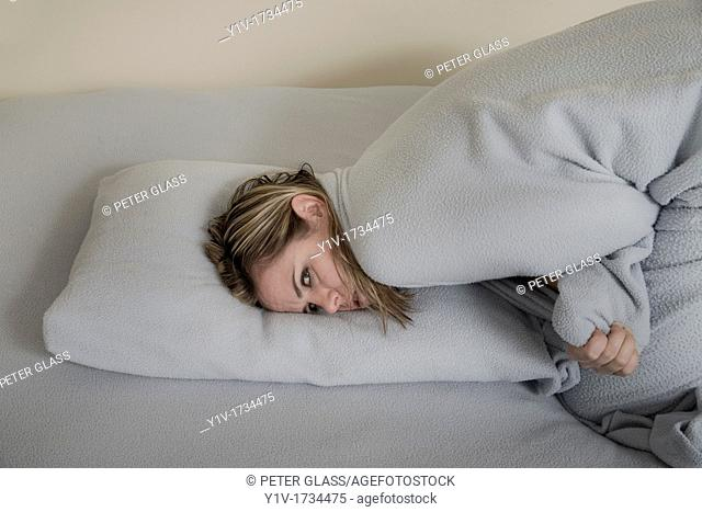 Woman leaning on her bed