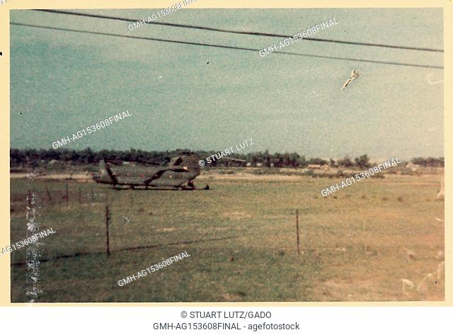 Twin rotor helicopter in a field on a United States military base during the Vietnam War, 1968. ()