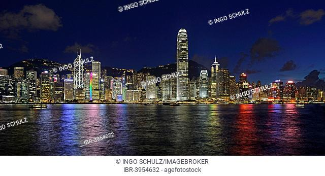 View at the blue hour from Kowloon on Hong Kong Island's skyline on Hong Kong River, Central, with Bank of China on the far left and IFC Tower far right