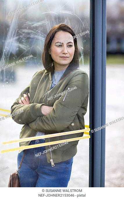 Woman waiting on bus stop