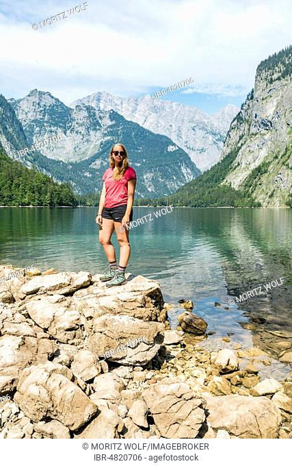Hiker stands on the shore of the Obersee, behind Watzmann, National Park Berchtesgaden, Berchtesgadenener Land, Upper Bavaria, Bavaria, Germany
