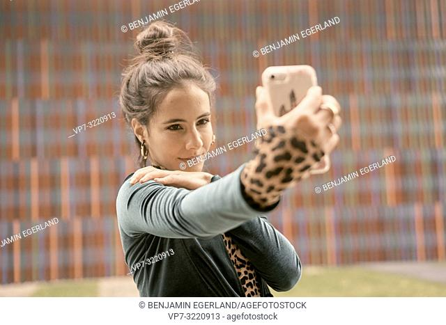 confident woman using smartphone, taking selfie, video conversation