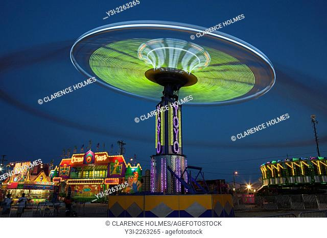 The colorfully illuminated Yo Yo spins on the midway at the Tennessee State Fair on September 5, 2014 at the Tennessee Fairgrounds in Nashville, Tennessee