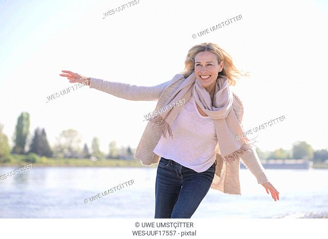 Carefree mature woman at the riverside