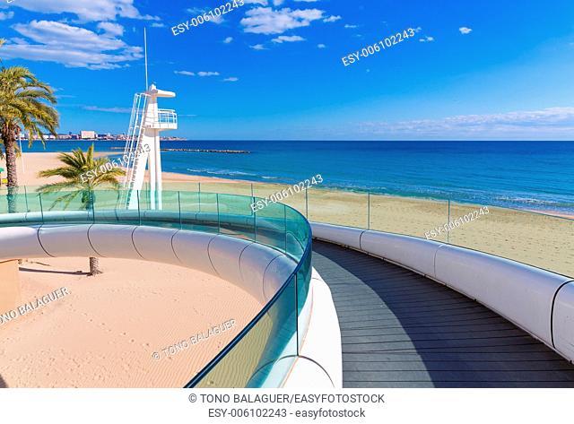 Alicante el Postiguet beach playa with modern pedestrian white bridge at Spain