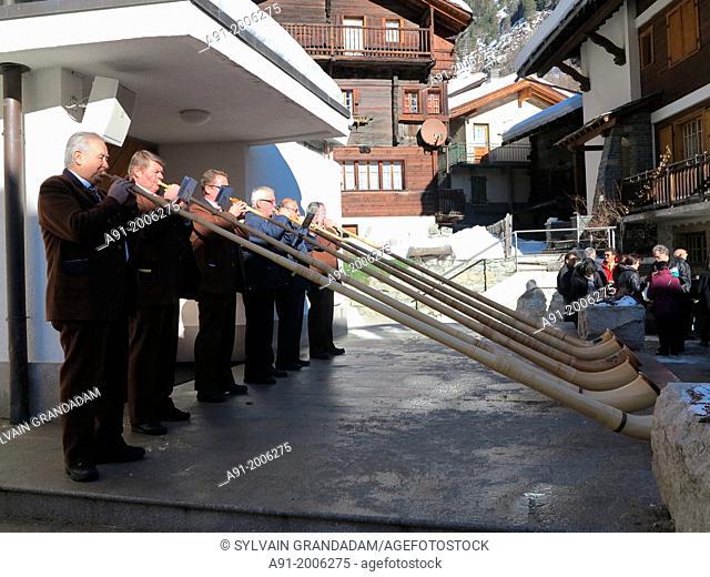 Switzerland, Valais, Herens valley, Evolene, new year mass with alp horn players