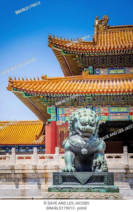 Stone statue and historical building, Beijing, Beijing Municipality, China