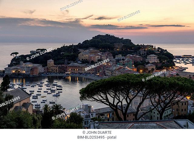 Scenic view of harbor at sunset, Sestri Levante, Liguria, Italy
