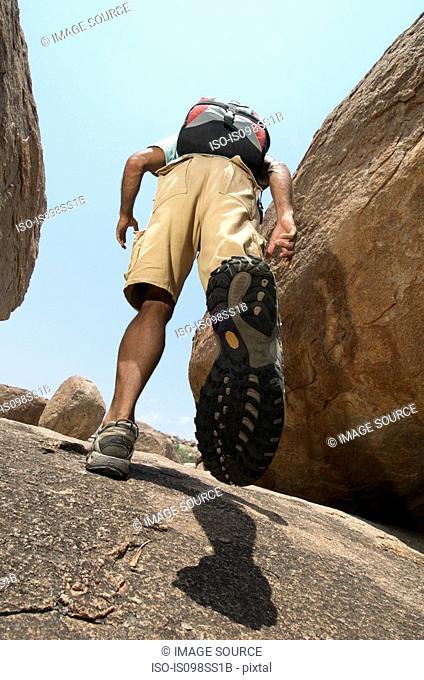 Man hiking in rocky terrain