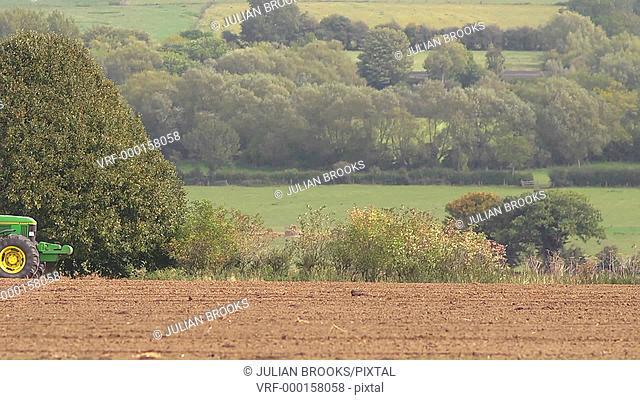 Rolling a field in Autumn, rural industry