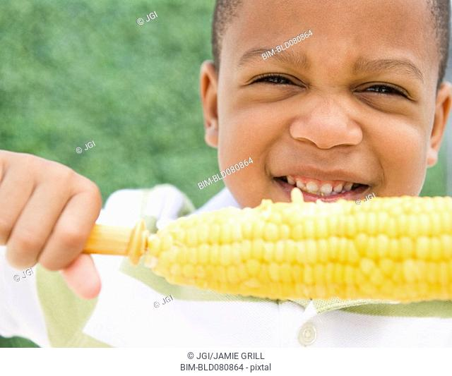 African American boy eating corn on the cob