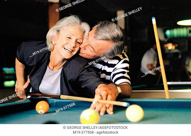 senior couple shooting pool