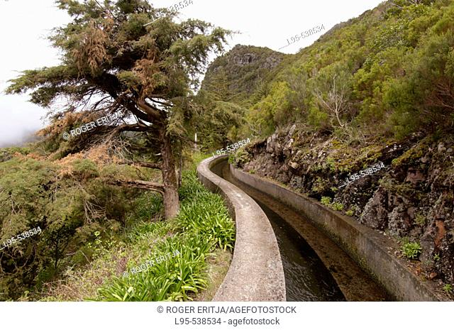 Levada, one of hundreds of ditches excavated since centuries ago in the slopes of the volcanic mountains of Madeira, Portugal, in order to drain