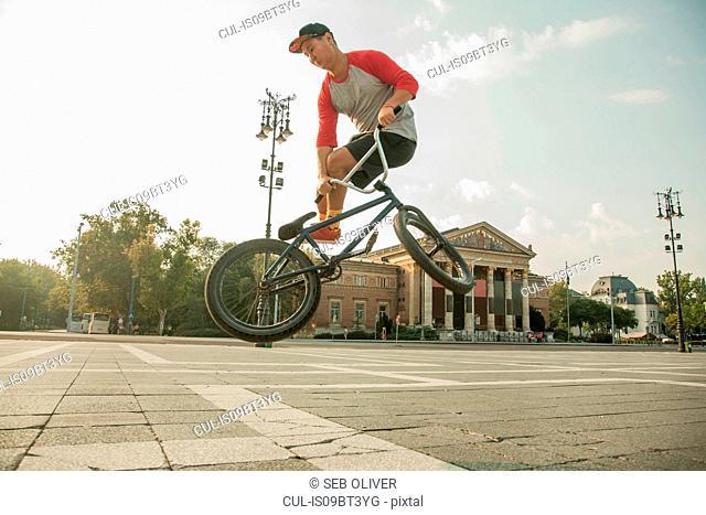 BMX cyclist doing stunt, Heroes' Square (Hosök Tere), Budapest, Hungary