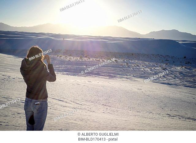 Caucasian woman photographing White Sands National Park, New Mexico, United States