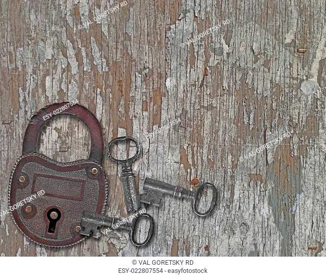 vintage padlock on a old wooden panel