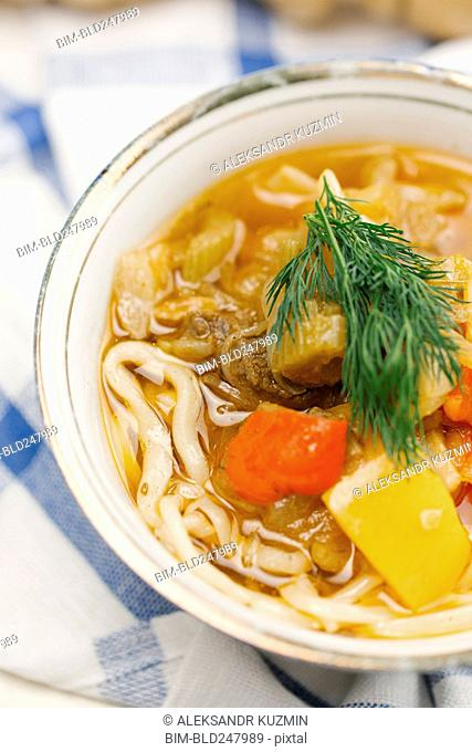 Garnish on bowl of soup with noodles
