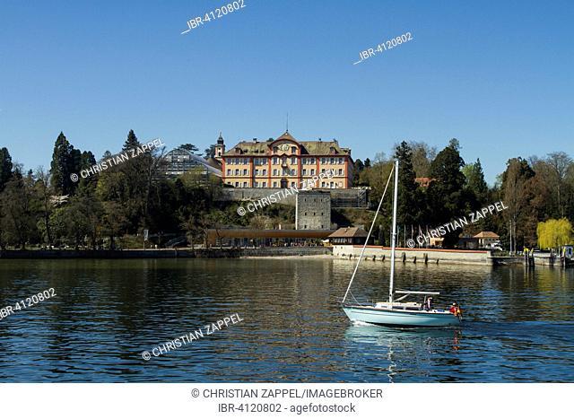 Schloss Mainau castle with sailing boat on Mainau Island, Lake Constance, Baden-Württemberg, Germany